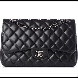 Chanel quilted lambskin Maxi Classic Flap handbag